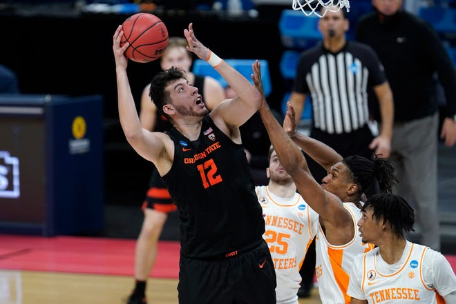 Oregon State center Roman Silva (12) shoots against Tennessee during the second half of a men's college basketball game in the first round of the NCAA tournament at Bankers Life Fieldhouse in Indianapolis, Friday, March 19, 2021.