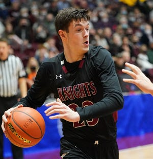 Aberdeen Christian's Brent Ekanger looks to pass around the Canistota defense on Thursday in the first round of the Class B state boys basketball tournament in Aberdeen.