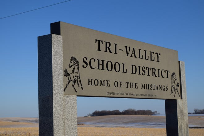 A sign at the Tri-Valley K-12 school as it stands in Colton, South Dakota on March 18, 2021.