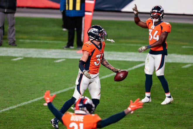 Broncos safety Justin Simmons celebrates his fourth-quarter interception of Dolphins quarterback Ryan Fitzpatrick in the end zone during Denver's win last November at Mile High Stadium.