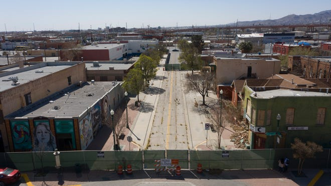 Weeds grow in the street in the Duranguito neighborhood in Downtown El Paso, photographed March 19, 2021.