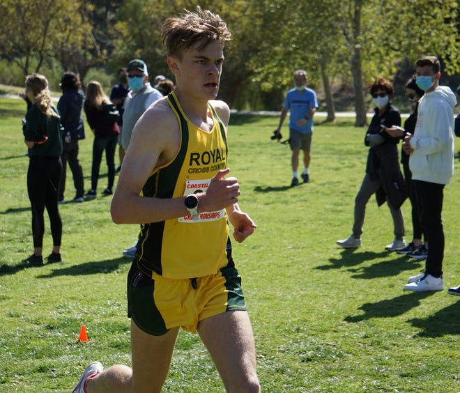 Angus Fitzgerald of Royal heads toward the finish line en route to winning the varsity boys individual title at the Coastal Canyon League Championships on Thursday in Camarillo.