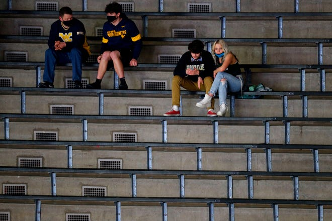 Fans sit in the stands before UCLA and Michigan State tip off at Mackey Arena in West Lafayette, Indiana.