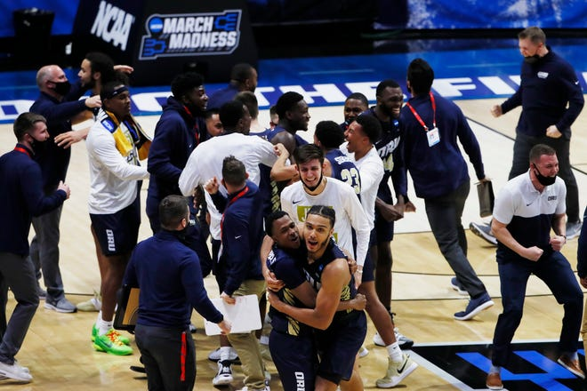 First round; Oral Roberts Golden Eagles celebrate after an overtime victory against the Ohio State Buckeyes in the 2021 NCAA Tournament at Mackey Arena on Mar 19, 2021. Oral Roberts upset Ohio State 75-72 in overtime.