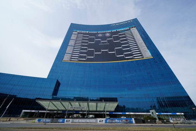 The NCAA bracket for the men's basketball tournament on the side of the JW Marriott in downtown Indianapolis symbolizes a slow return to normalcy.