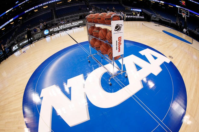 General view of basketballs on the NCAA logo prior to a men's college basketball game between the Colorado Buffaloes and Pittsburgh Panthers during the second round of the 2014 NCAA Tournament at Amway Center.