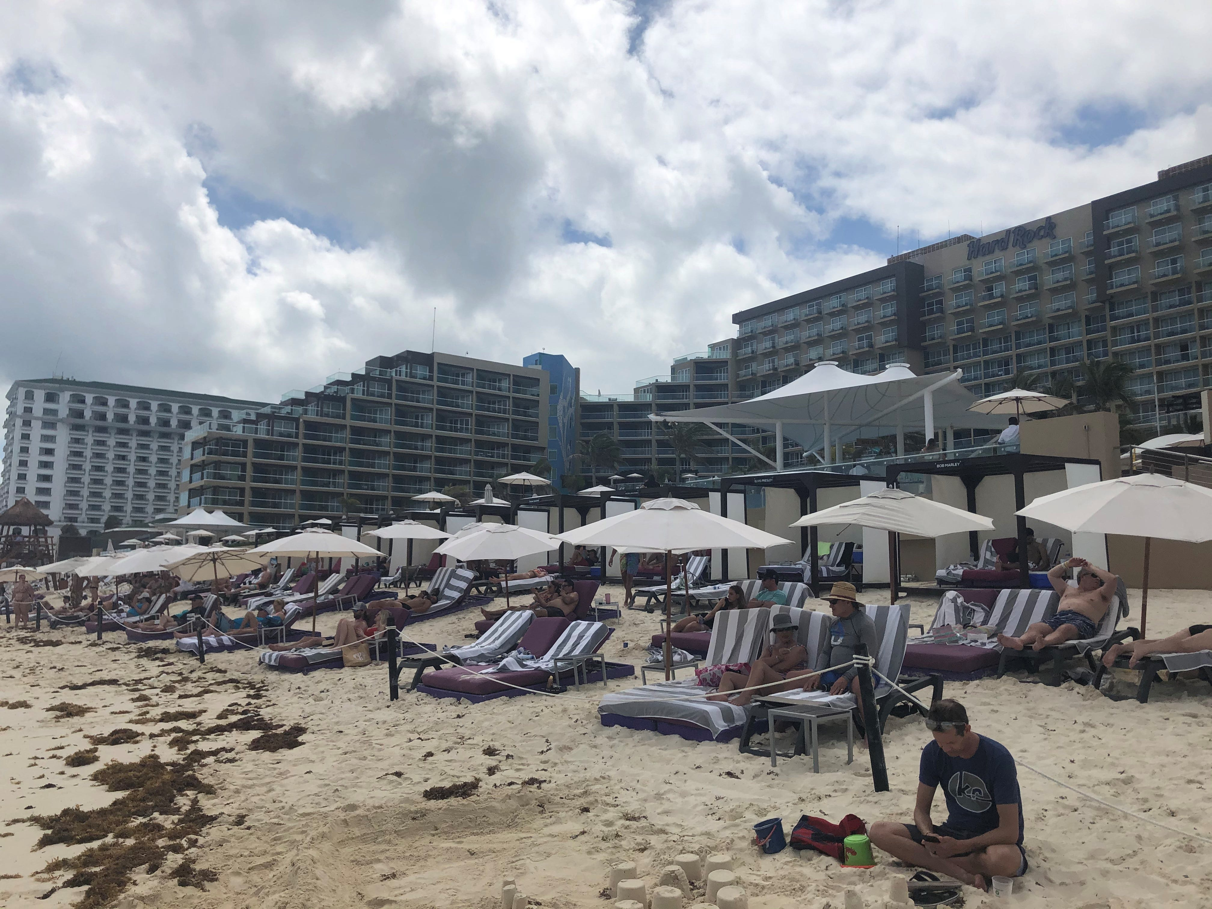 The beach in front of the Hard Rock Hotel Cancun was filled with sunbathers during spring break.