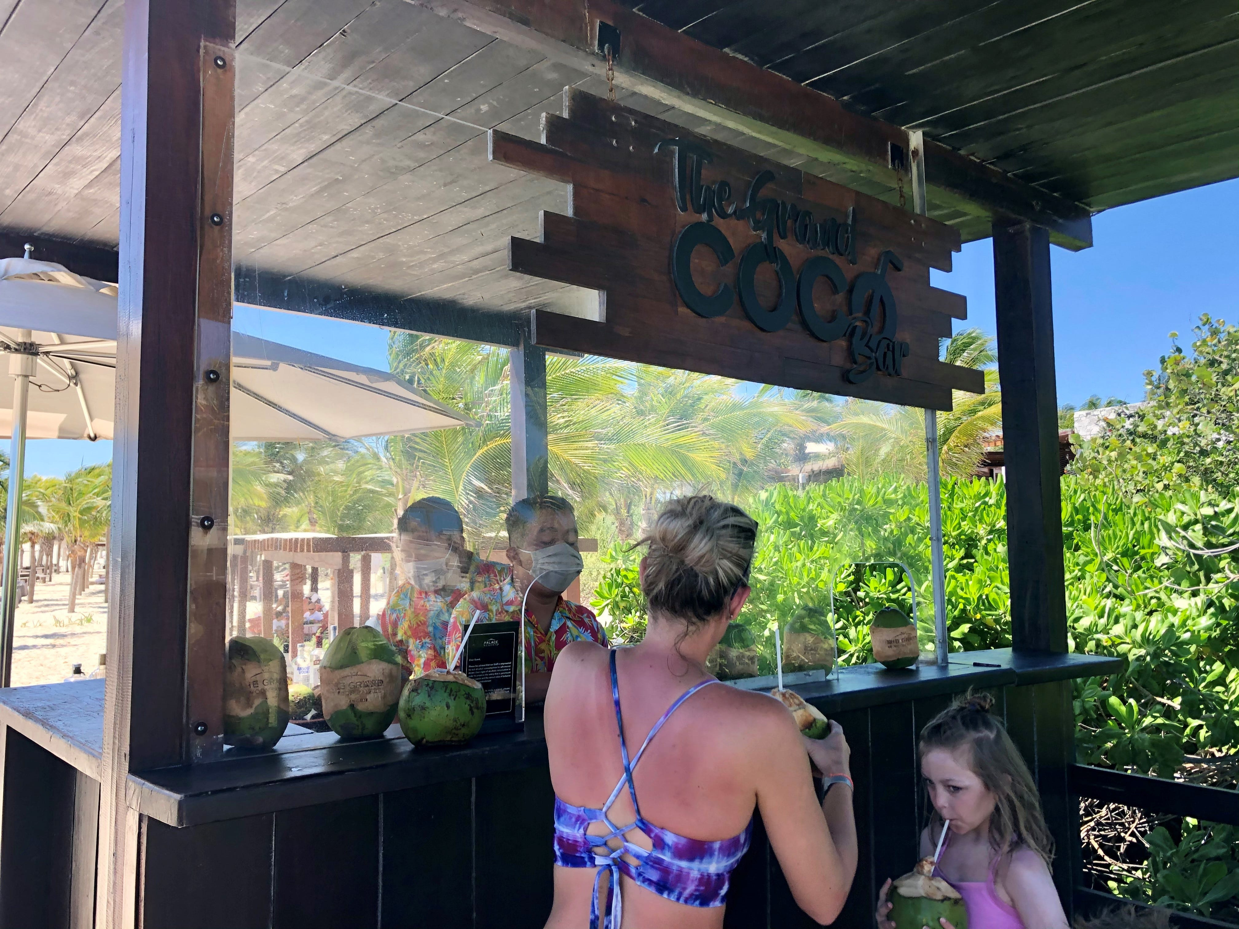 Guests at The Grand at Moon Palace, a luxury resort in Cancun, Mexico, are treated to complimentary drinks in souvenir coconuts.  The resort has been serving as many as 400 a day, back to pre-pandemic levels.