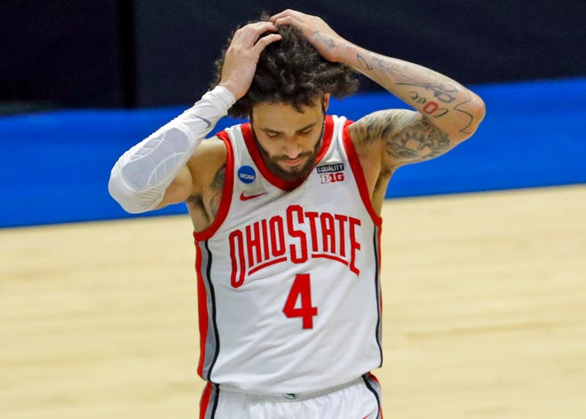 Ohio State Buckeyes guard Duane Washington Jr. (4) reacts to their loss to Oral Roberts Golden Eagles in overtime during the first round of the 2021 NCAA Tournament.