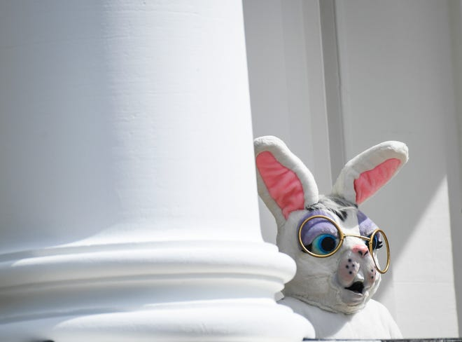 The Easter Bunny lurks at the White House during the last Easter Egg Roll, in 2019, with then-President Donald Trump and first lady Melania Trump, on April 22, 2019.