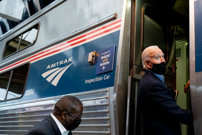 Then-presidential candidate Joe Biden boards his train at Amtrak's Pittsburgh Train Station in Pittsburgh on Sept. 30, 2020.
