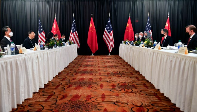 Secretary of State Antony Blinken, second from right, joined by national security adviser Jake Sullivan, right, speaks while facing Chinese Communist Party foreign affairs chief Yang Jiechi, second from left, and China's State Councilor Wang Yi, left, at the opening session of US-China talks at the Captain Cook Hotel in Anchorage, Alaska, Thursday, March 18, 2021.