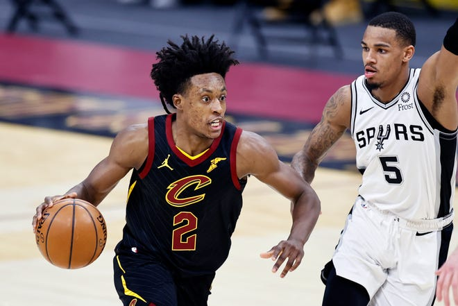 Cavaliers guard Collin Sexton (2) scored 29 points but it wasn't enough in a 116-110 loss to the San Antonio Spurs on Friday night in Cleveland. [Ron Schwane/Associated Press]