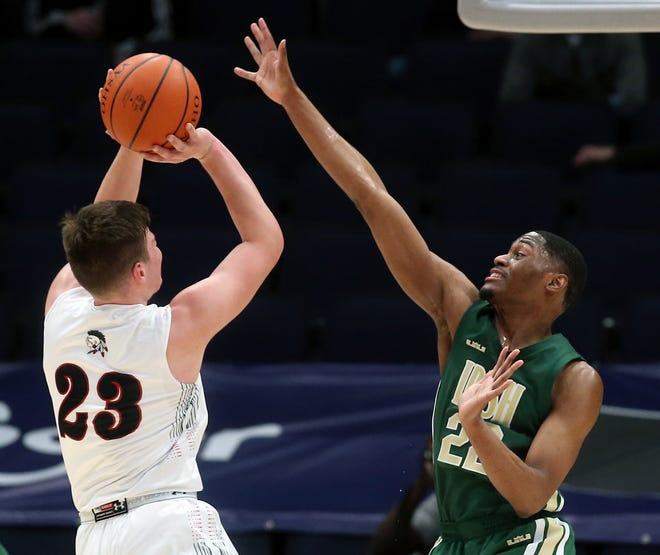 St. Vincent-St. Mary senior Malaki Branham, right, blocks the shot of Lima Shawnee's George Mangas during the second half of a Division II state semifinal Saturday in Dayton. [Jeff Lange/Beacon Journal]