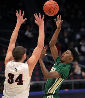 STVM's Sencire Harris, facing, puts a shot up over Shawnee's Tyson Elwer during the second half of a Division II state semifinal, Saturday, March 20, 2021, in Dayton, Ohio. [Jeff Lange/Beacon Journal]