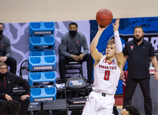 Texas Tech coach Chris Beard, right, looks on as guard Mac McClung shoots a 3-pointer during  Tech's win over Utah State in the NCAA Tournament on Friday. The Red Raiders were part of the Big 12's 4-0 start to the tourney.