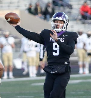 Mount Union quarterback Braxton Plunk throws to a receiver during the Purple Raiders' game against John Carroll Friday, March 19, 2021 at Mount Union Stadium.