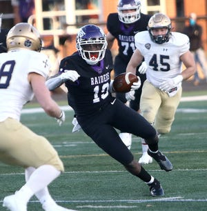 Mount Union wide receiver Jaden Manley gains extra yards after a catch during the Purple Raiders' game against John Carroll Friday, March 19, 2021 at Mount Union Stadium.