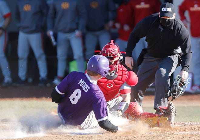 Ashland's Logan Moss (8) is tagged out at home plate by Seton Hill catcher Vincenzo Rauso (35) for the final out of the game during the Eagles' 8-7 loss Saturday at Donges Field.