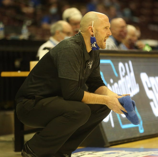 Boonville girls basketball coach Jaryt Hunziker shouts encouragement to his players in the second half Friday night in a Class 4 semifinal game Friday night at JQH Arena in Springfield.