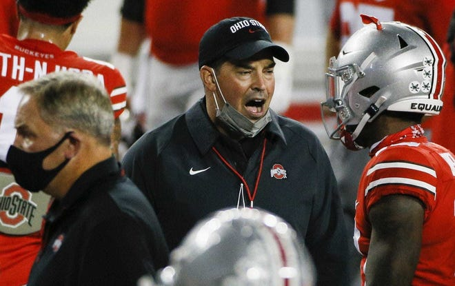 Ohio State football coach Ryan Day, seen during the Buckeyes' Nov. 7 game against Rutgers, received a COVID-19 vaccine shot on Friday along with his wife, Christina.