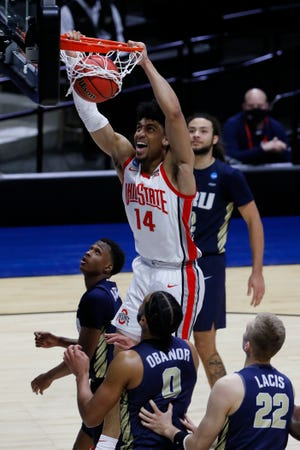Ohio State forward (14) Justice Sueing battled through a groin injury to score 11 points in the Buckeyes' NCAA Tournament loss to Oral Roberts.