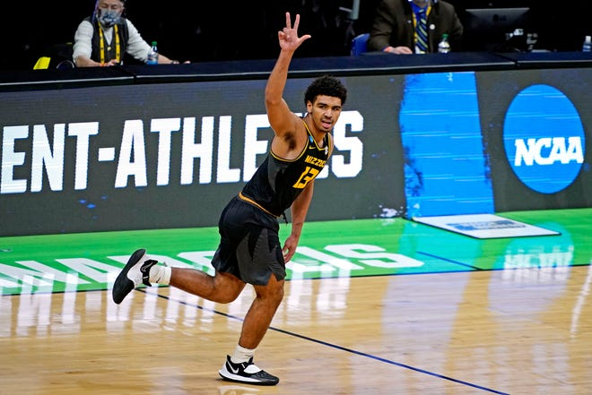Missouri guard Mark Smith (13) reacts after making a 3-pointer against Oklahoma during the first round of the NCAA Tournament on March 20 at Lucas Oil Stadium in Indianapolis.