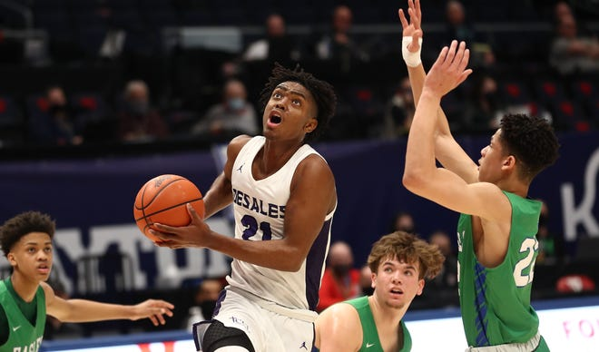 DeSales senior Des Watson (21) drives to the basket during the Stallions' 51-34 win over Dayton Chaminade Julienne in a Division II boys basketball state semifinal on Saturday. Watson finished with 21 points.