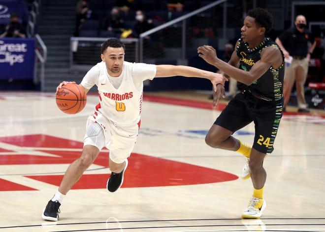 Worthington Christian's DJ Moore, seen here in an OHSAA Division III state semifinal game on March 19, announced Wednesday that he's forgoing his senior year of high school and enrolling at Liberty University this fall.