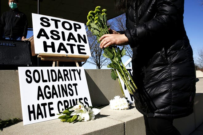Community members protested hate crimes against Asian Americans in Bicentennial Park in March.