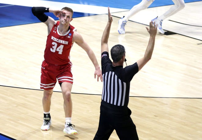 Wisconsin Badgers guard Brad Davison (34) celebrates a  three point shot in the final seconds of the first half during the first round of the 2021 NCAA Tournament on Friday, March 19, 2021, at Mackey Arena in West Lafayette, Ind.