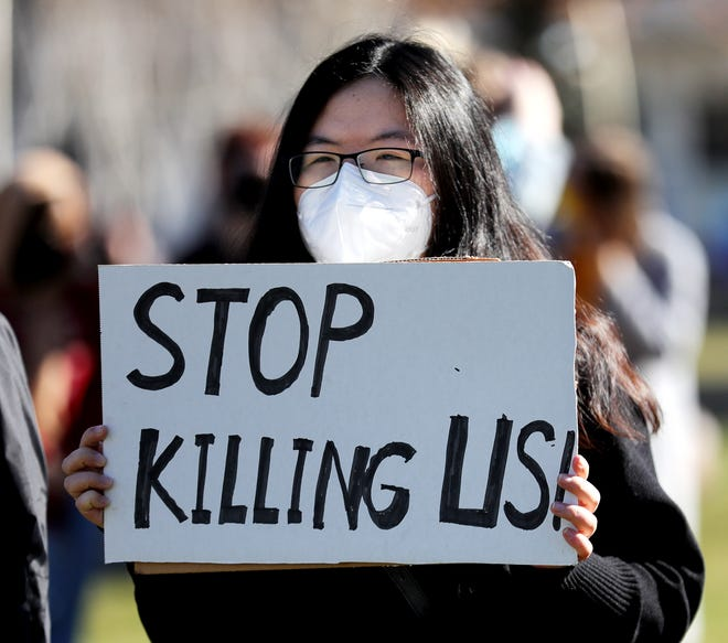 Mengyi Chen of Lewis Center attends a rally of community members and interfaith leaders gathered to protest the violence done to Asian Americans at Bicentennial Park on March 20. Participants condemned the murders of eight people killed in Atlanta and other instances of hatred toward Asian Americans.