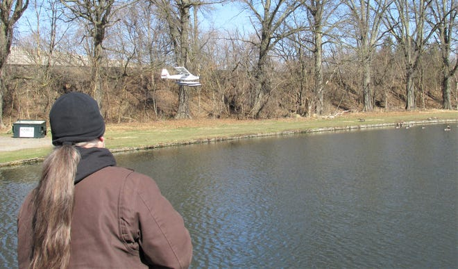 Adrian Baker of Wooster controls his RC airplane as he flies it over the pond at Schellin Park in Wooster. Baker said his Little Timber UMX is a good plane for beginners, as it helps develop confidence.
