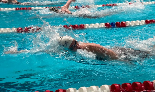 McDowell's Jazmyn Myers competes in the 500-yard freestyle on Saturday in the PIAA Class 3A championships at Cumberland Valley High School.