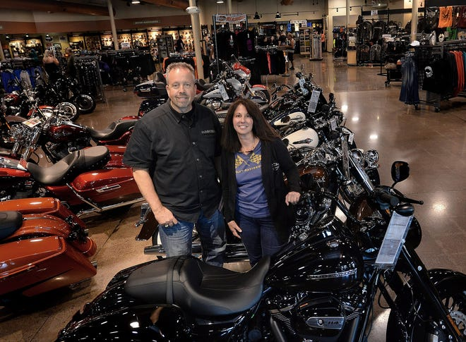 Harley-Davidson of Erie dealership co-owners Kelly Lapping, at left, and Susan Lapping, at right, are shown in July 2019 at their dealership in Millcreek Township during BikeFest. [JACK HANRAHAN/ERIE TIMES-NEWS]