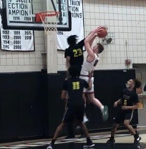 Erie High senior Jamie Smith blocks an Upper St. Clair shot during a PIAA Class 6A quarterfinal at Upper St. Clair High School on Saturday.