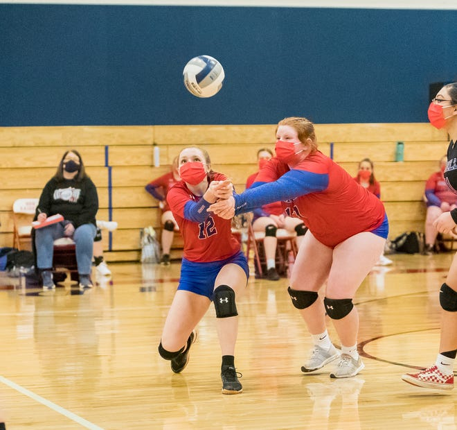 Hornell's Kayla Turner (12) and Cassidy Gadson (11) converge on a return shot in Friday night's home contest.