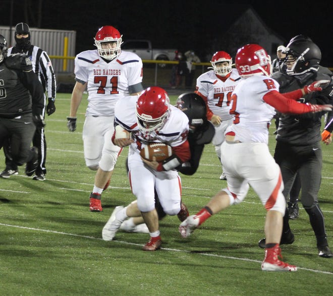 Hornell's Brennan Khork fights through a defender during a big run on Friday night in Warsaw.