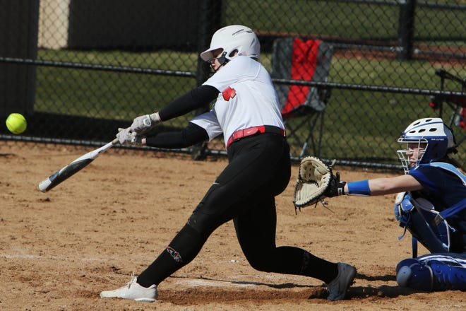 Southeastern Community College's Trinity Krabill (4) hits a home run, during the first game of a double header against Des Moines Area Community College, Saturday March 20, 2021 at SCC's Wagner Athletic Complex.