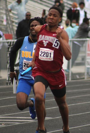 Raines runner Kenton Kirkland (2201) pulls ahead of Miami Northwestern in the finishing straight to give the Vikings the 4x400 relay title and the overall boys championship at the Bob Hayes Invitational.