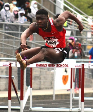 Parker's Desmyn McCall clears a hurdle on his way to victory in the 110-meter hurdles at the Bob Hayes Invitational Track Meet.