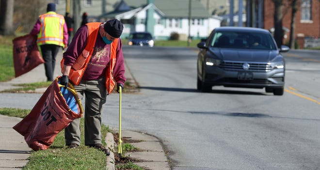 Jim Burke picks up litter along North Myrtle School Road Saturday morning, March 20, 2021, for the Great American Cleanup.