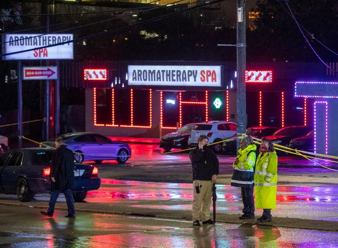 Atlanta police officers and detectives respond outside Aromatherapy Spa and Gold Spa in Atlanta, where several people were shot on March 16, 2021.