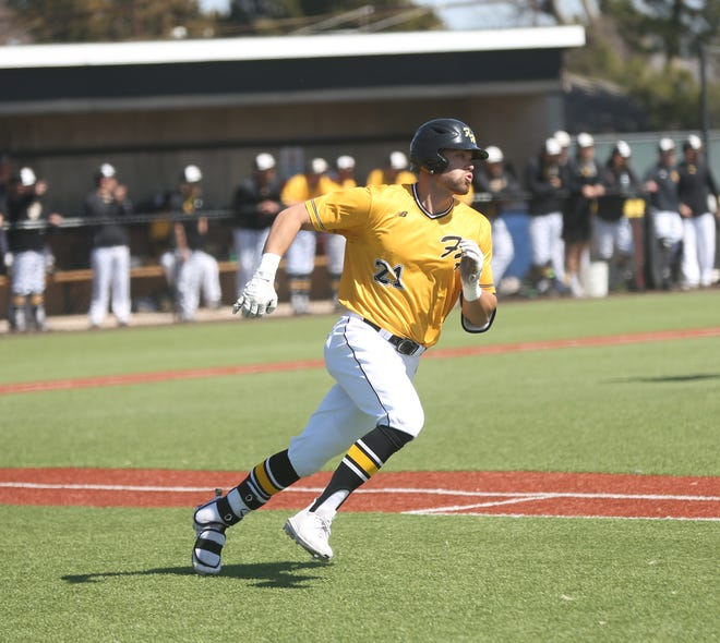 FHSU's Grant Schmidt rounds first base during a game earlier this season.