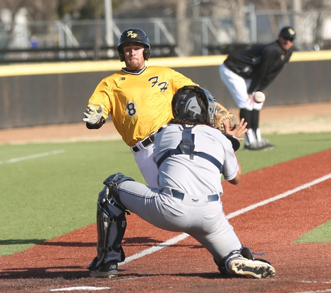 FHSU's Ed Scott approaches home plate just as Rogers State's Jonathan Soto collects a one-hop throw. Soto applied the tag for the final out.