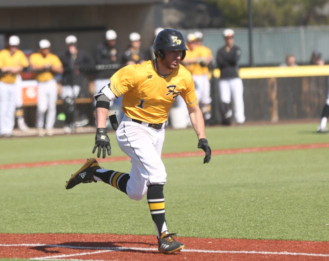 Drake Angeron sprints toward first base during a game this season. He was named honorable mention All-MIAA.