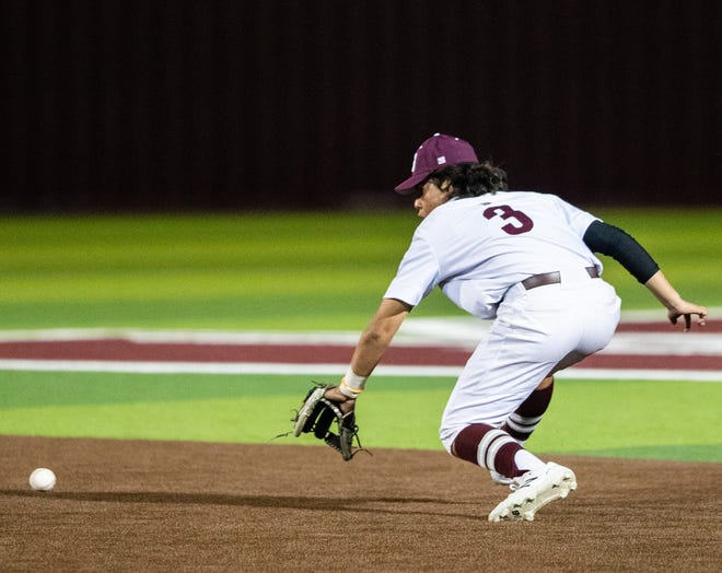 Sherman second baseman Landon Gutierrez fields a ground ball during the Bearcats' loss against McKinney North in 10-5A play.