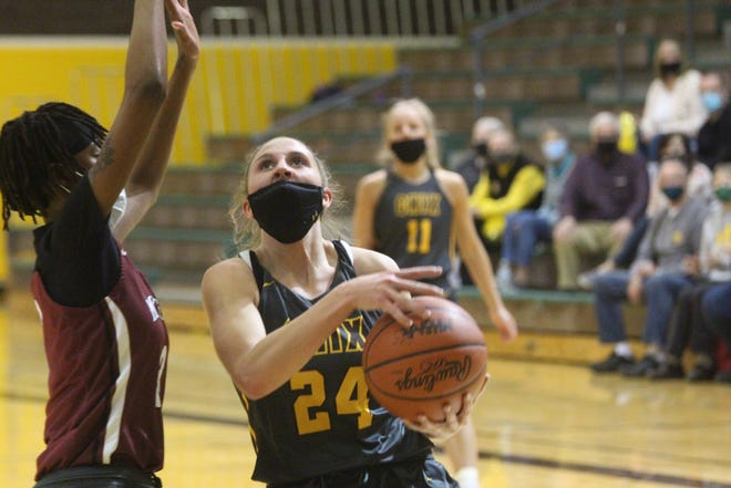 Zeeland East junior Maddie Schuur goes up for a layup in their win over Muskegon on Friday, March 19, 2021