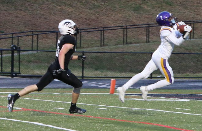 North Henderson wide receiver Jaylon Croft makes a catch for a touchdown during the second quarter of Friday's game at North Buncombe.