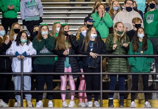 Peoria Notre Dame fans in the student section cheer on the Irish as they battle Peoria High on Friday, March 19, 2021 at Peoria Stadium.